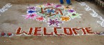 Welcome sign in chalk and flowers