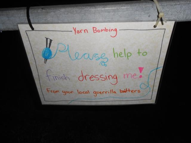 Yarn bombing sign