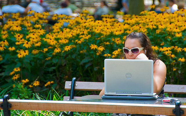 Woman reading from a laptop