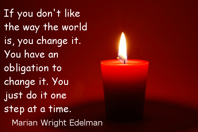 Red candle with Edelman quote