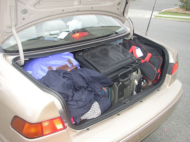 Car boot packed with luggage