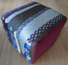 An ottoman Cathy recovered with old ties