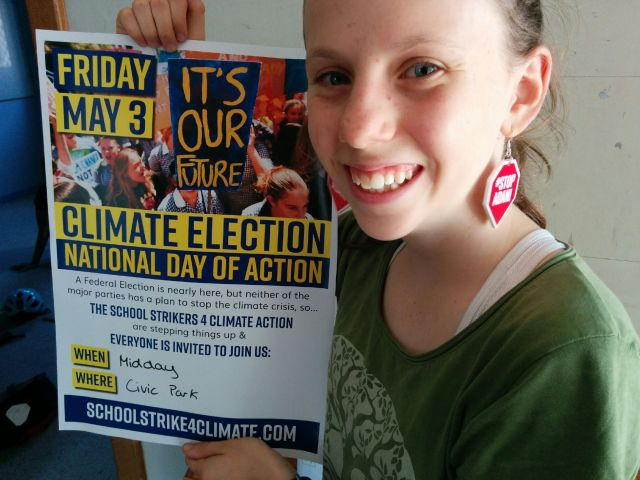 Alexa holding a poster advertising the School Strike 4 Climate on 3 May 2019